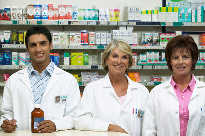 View of three pharmacist smiling for the camera